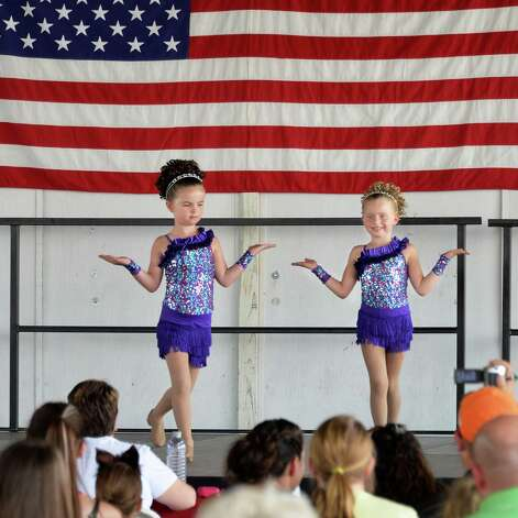 Alyson O'Connor, left, 6, and Emily Hye, 5, of Ballston Spa perform during the under 7 talent show on opening day of the Saratoga County Fair Tuesday July 22, 2014, in Ballston Spa, NY.  (John Carl D'Annibale / Times Union) Photo: John Carl D'Annibale / 00027870A