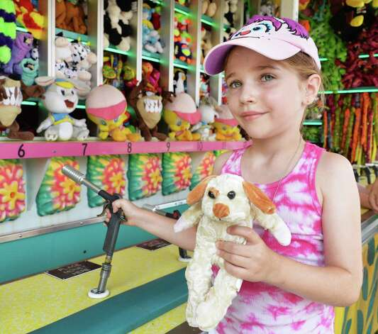 Six-year-old Olivia Lill of Milton with a stuffed animal she won on a midway game on opening day of the Saratoga County Fair Tuesday July 22, 2014, in Ballston Spa, NY.  (John Carl D'Annibale / Times Union) Photo: John Carl D'Annibale / 00027870A