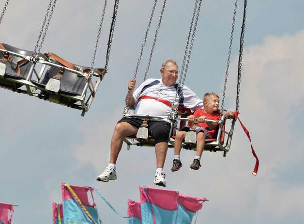 Larry Powell of Bluffton, S.C., and grandson Ty Powell, 5, of Saratoga Springs ride the Vertigo on opening day of the Saratoga County Fair Tuesday July 22, 2014, in Ballston Spa, NY.  (John Carl D'Annibale / Times Union) Photo: John Carl D'Annibale / 00027870A