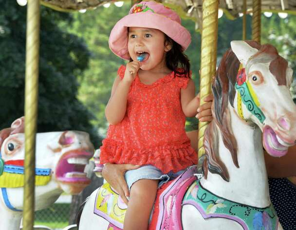 Three-year-old Isabella Molina of Halfmoon rides the Merry-go-round on opening day of the Saratoga County Fair Tuesday July 22, 2014, in Ballston Spa, NY.  (John Carl D'Annibale / Times Union) Photo: John Carl D'Annibale / 00027870A
