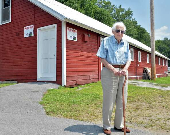 "Joseph ""Dixie"" Aufiero, 97, long-time fair worker and former grounds superintendent, in front of the barn named in his honor on opening day of the Saratoga County Fair Tuesday July 22, 2014, in Ballston Spa, NY.  (John Carl D'Annibale / Times Union) Photo: John Carl D'Annibale / 00027870A"