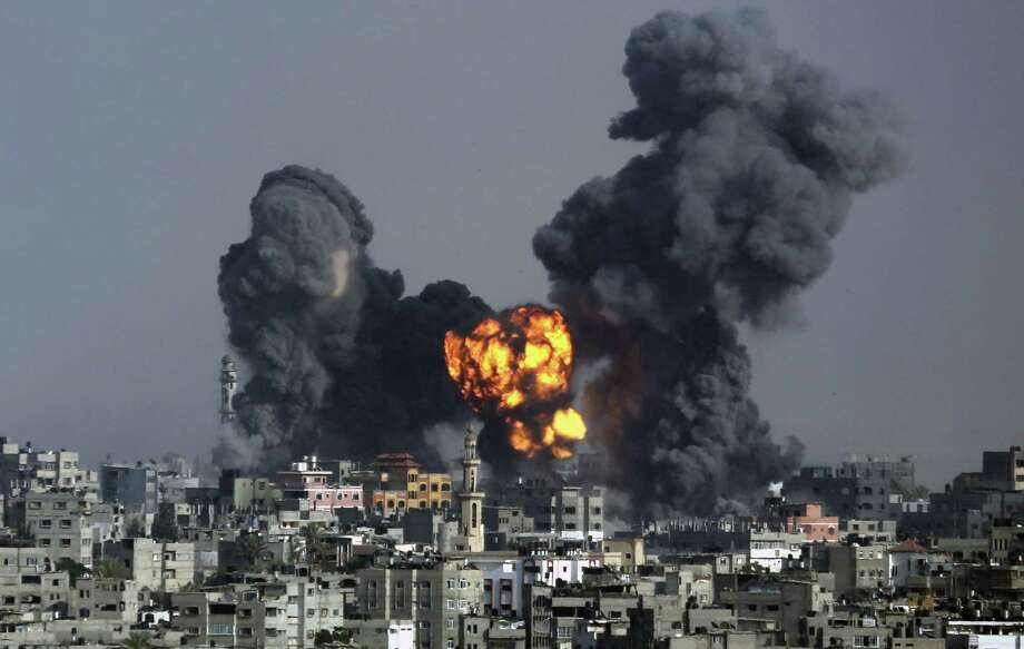 Smoke and fire from the explosion of an Israeli strike rise over Gaza City. Photo: Hatem Moussa / Associated Press / AP
