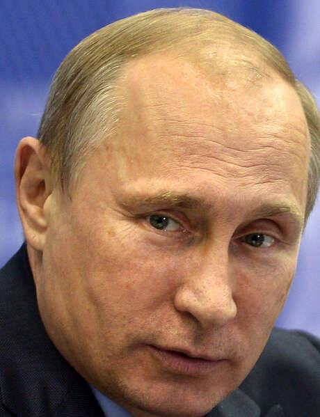 Russian President Vladimir Putin pledged to use Russia's influence on separatists. / RIA Novosti Kremlin Press Servic