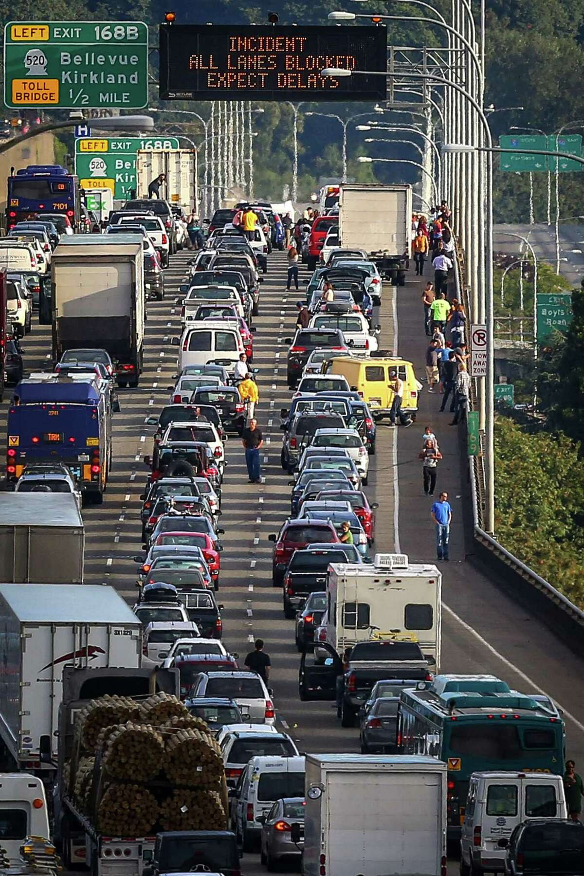 Traffic on the Interstate 5 Ship Canal Bridge is stopped and motorists stand on the bridge deck as traffic on the main Seattle thoroughfare comes to a standstill for the motorcade of President Barack Obama. Obama was in town to make a pair of fundraiser stops on Tuesday, July 22, 2014.