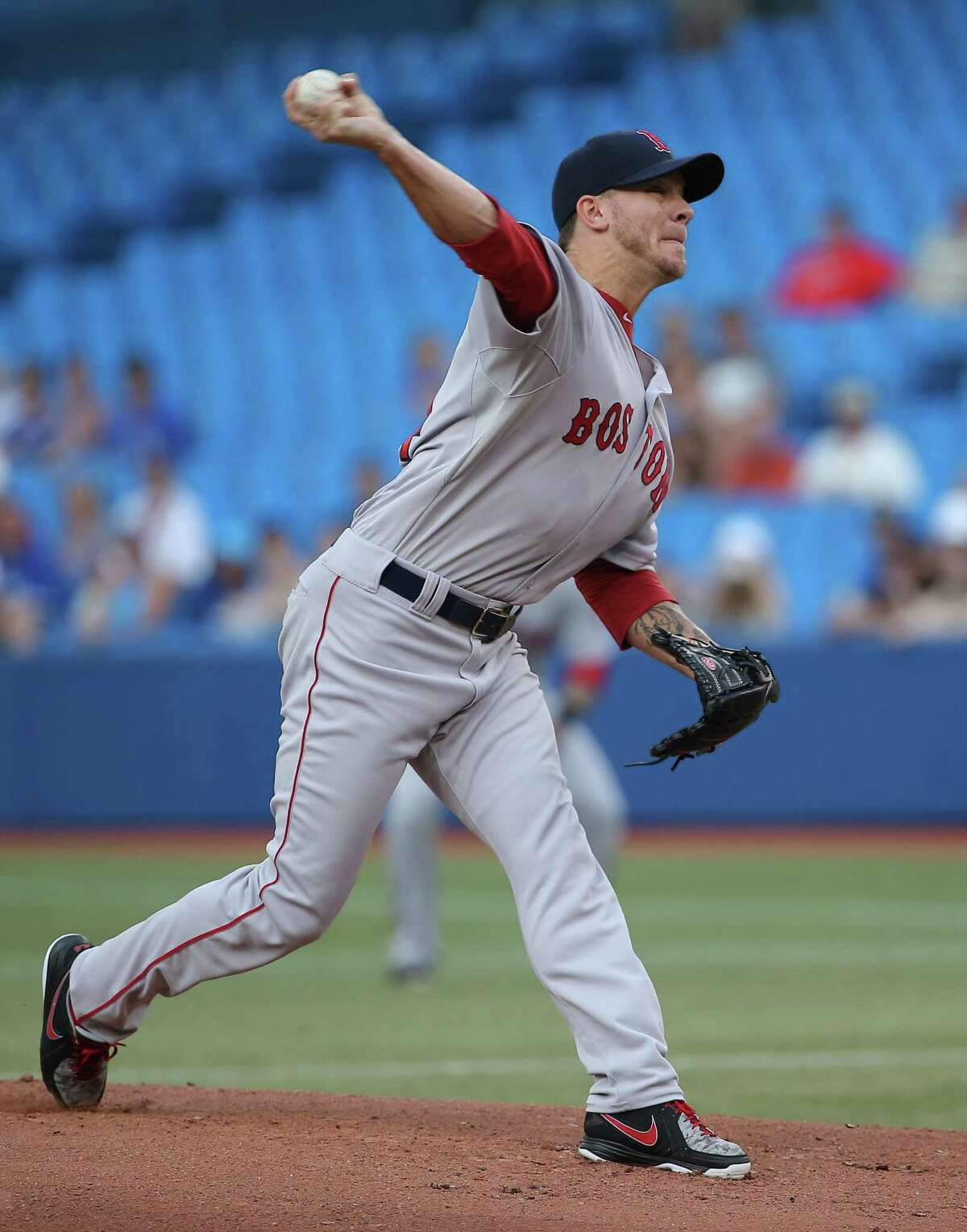 TORONTO, CANADA - JULY 22: Jake Peavy #44 of the Boston Red Sox delivers a pitch in the first inning during MLB game action against the Toronto Blue Jays on July 22, 2014 at Rogers Centre in Toronto, Ontario, Canada. (Photo by Tom Szczerbowski/Getty Images) ORG XMIT: 477586637
