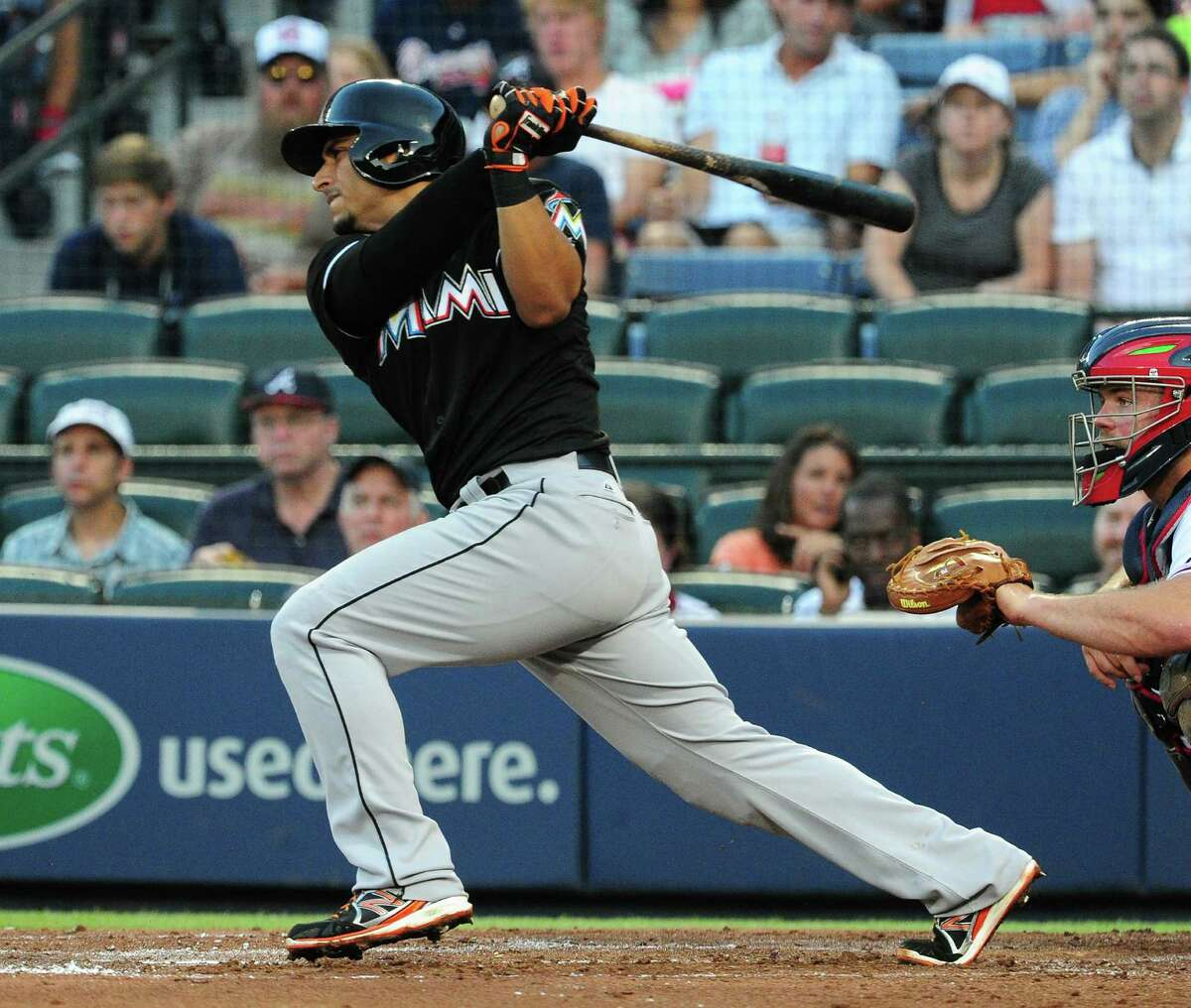 ATLANTA, GA - JULY 22: Donovan Solano #17 of the Miami Marlins hits a fourth inning double against the Atlanta Braves at Turner Field on July 22, 2014 in Atlanta, Georgia. (Photo by Scott Cunningham/Getty Images) ORG XMIT: 477586667