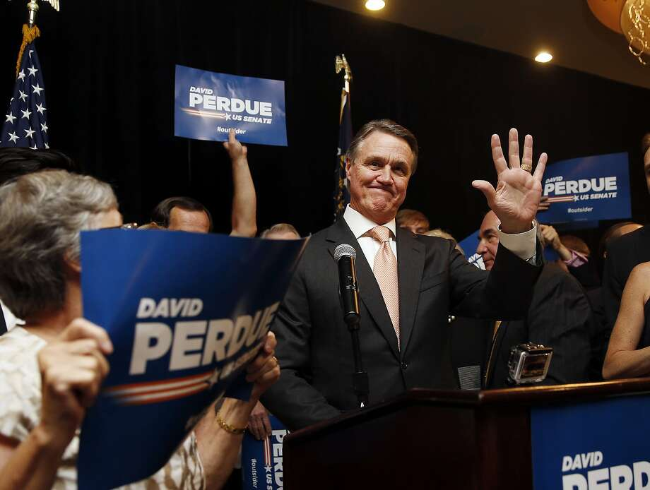 David Perdue greets supporters at a victory party in Atlanta after winning the GOP Senate runoff. Photo: John Bazemore, Associated Press