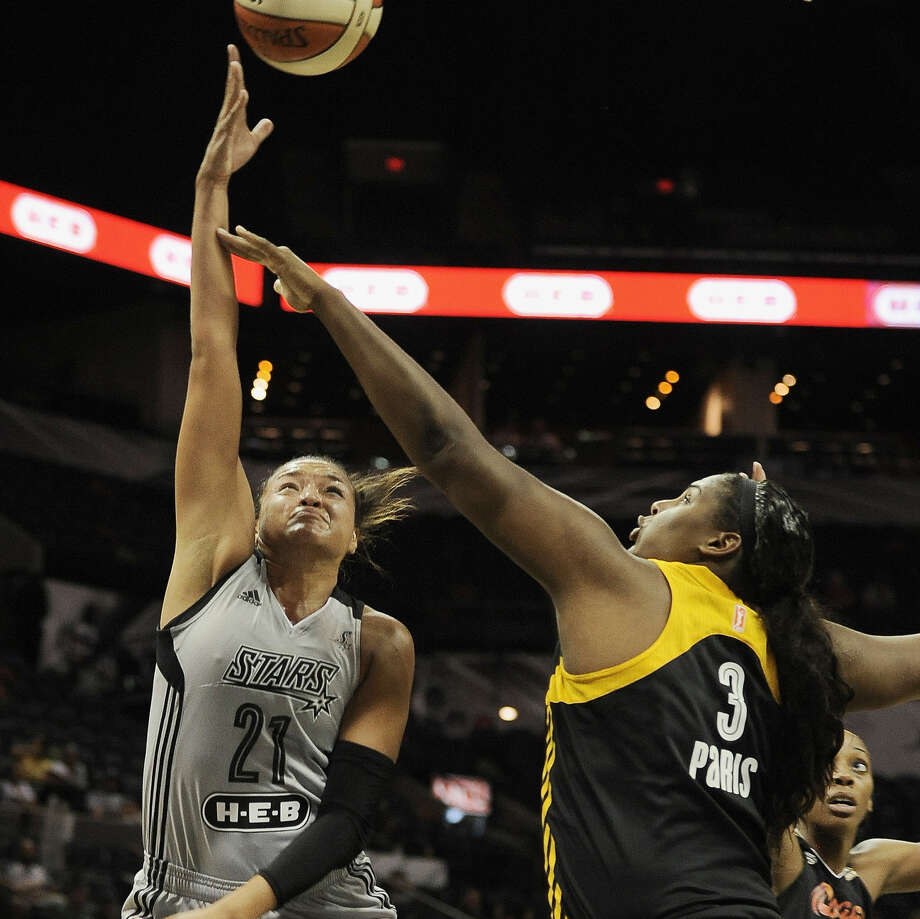 Stars rookie Kayla McBride, whose 26 points helped overcome a pair of career-highs for Tulsa, shoots over the Shock's Courtney Paris in the first half at the AT&T Center. Photo: Darren Abate / For The Express-News / Express-News