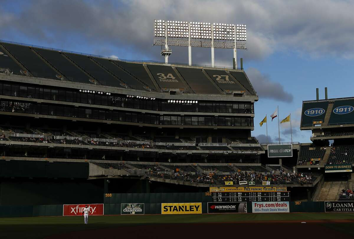 Oakland Athletics' Nick Punto warms up before playing Houston Astros in MLB game at O.co Coliseum in Oakland, Calif. on Tuesday, July 22, 2014.