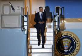 President Barack Obama disembarks Air Force One as he arrives at San Francisco International Airport in San Francisco, Calif., on Tuesday, July 22, 2014. The President is in the Bay Area to raise funds.