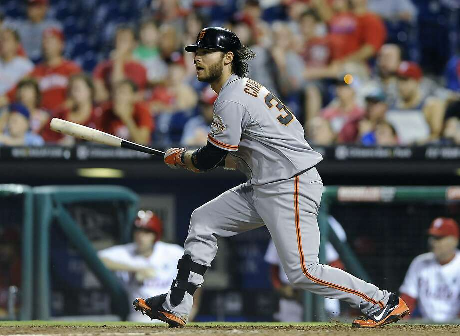 Shortstop Brandon Crawford's three-run double in the 14th inning knocked in the go-ahead runs for the Giants, who used nine pitchers a night after they used six. Photo: Michael Perez, Associated Press