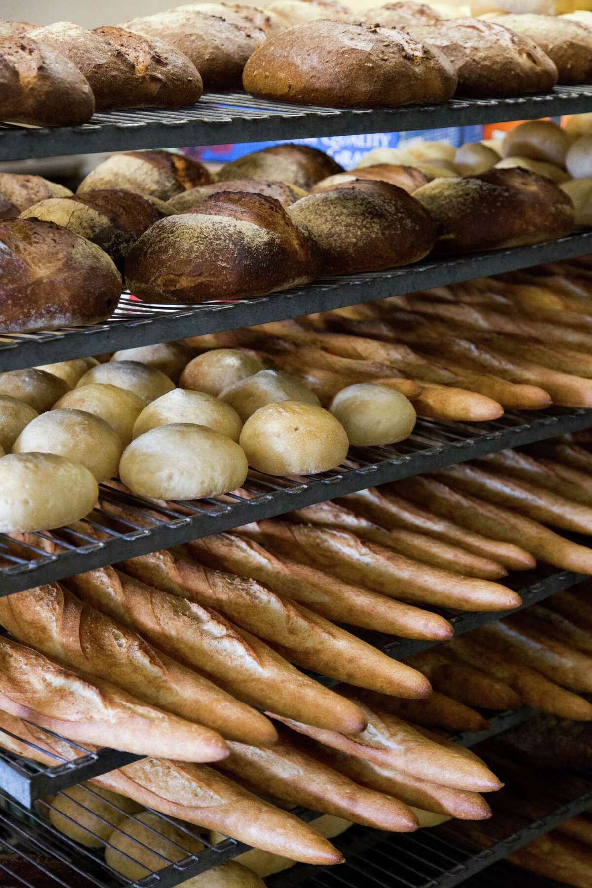 A variety of freshly baked artisan breads cool on the racks at Hush-Harbor Bakery in Atascadero. Among the offerings: sourdough, rustic Italian, ciabatta, brioche and whole wheat.