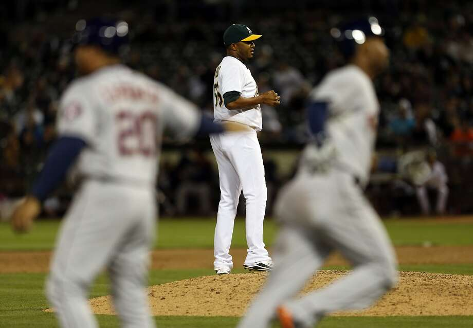 Fernando Abad reacts to the 12th-inning home run by light-hitting Astros left fielder L.J. Hoes that sank the A's. Photo: Scott Strazzante, The Chronicle