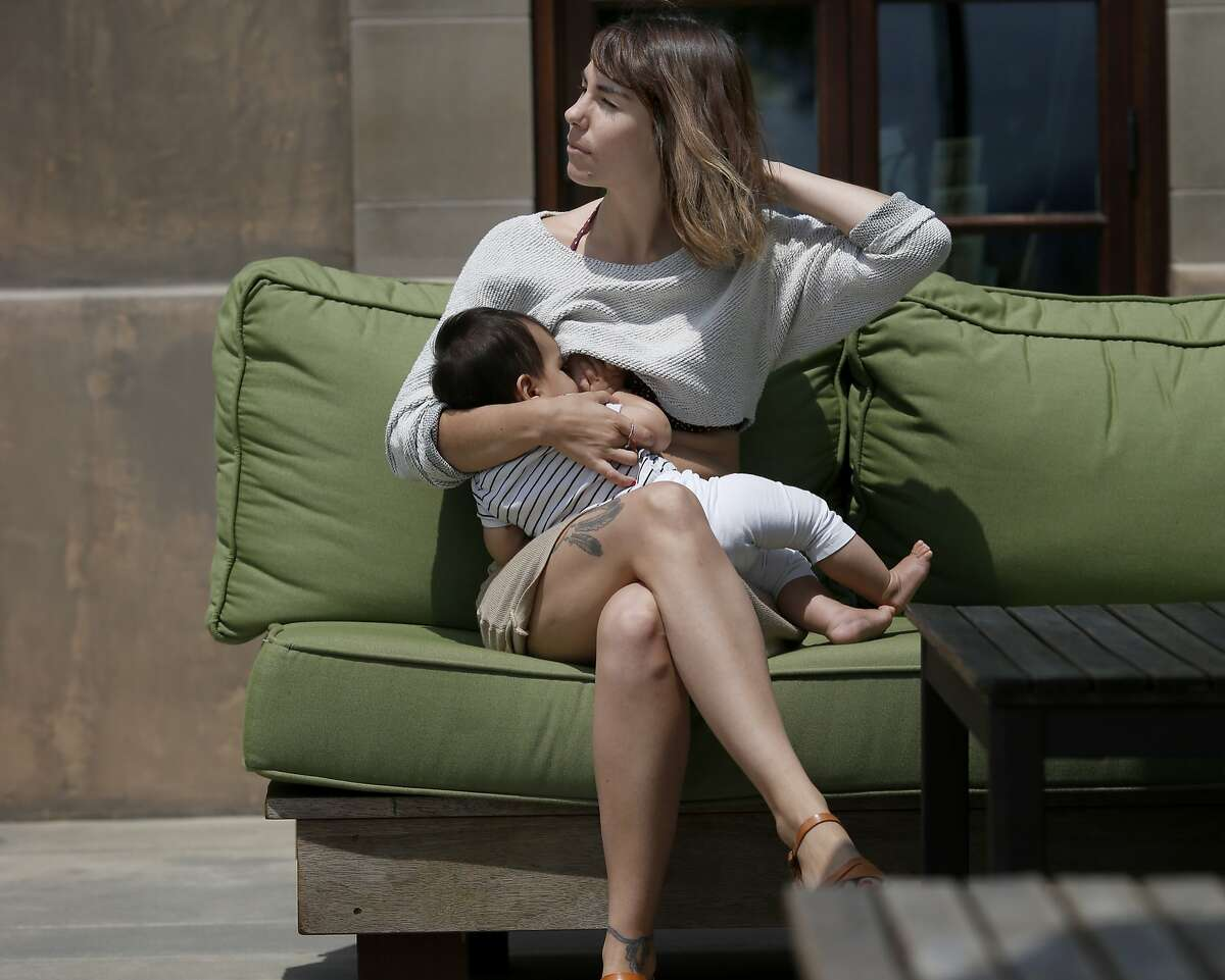 """Mandee Jaigirdar breastfeeds her nine month old daughter Lila Wednesday July 16, 2014 during a recent visit to the wine country. Mandee Jaigirdar and other """"instagram Moms"""" are planning a protest at Instagram/FB headquarters stemming from photos of breastfeeding being removed from the picture website."""