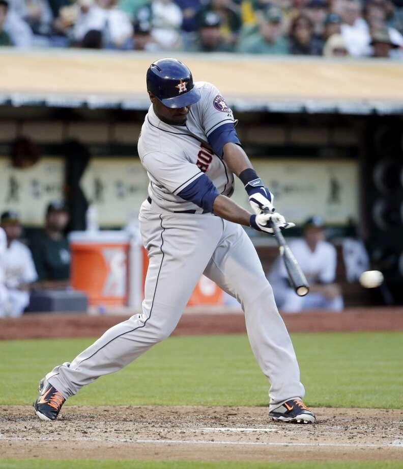 July 22: Astros 3, Athletics 2  Chris Carter drives in two runs with a single during the third inning. Photo: Associated Press