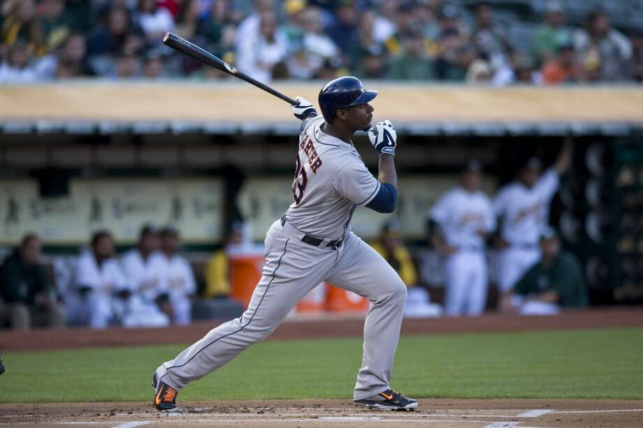 Chris Carter hits a double during the first inning. Photo: Jason O. Watson, Getty Images
