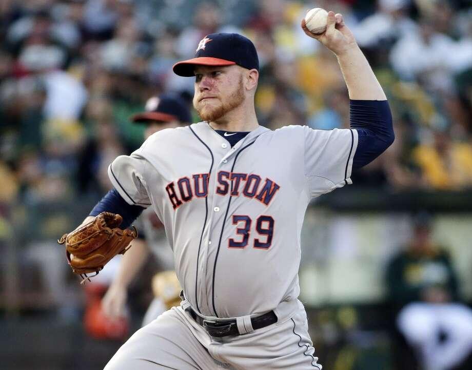 Astros starting pitcher Brett Oberholtzer throws during the first inning. Photo: Associated Press