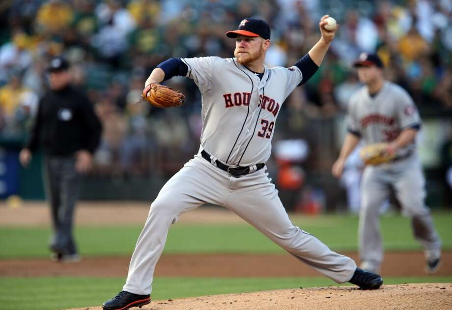 Astros starting pitcher Brett Oberholtzer works in the first inning. Photo: RAY CHAVEZ, McClatchy-Tribune News Service