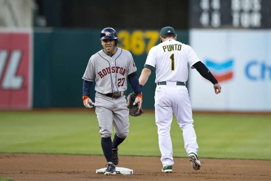 Jose Altuve returns to the dugout after getting tagged out at second base by Nick Punto during the first inning. Photo: Jason O. Watson, Getty Images