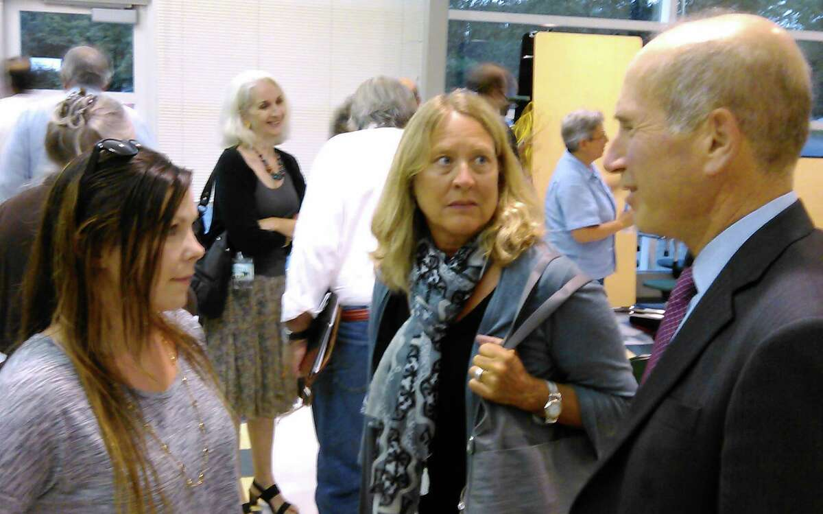 Joel Z. Green, right, the lawyer who represented opponents of an apartment project proposed for Bronson Road, talks with Krista Grant, a Bronson Road resident, after the Town Plan and Zoning Commission voted unanimously denied the plan.