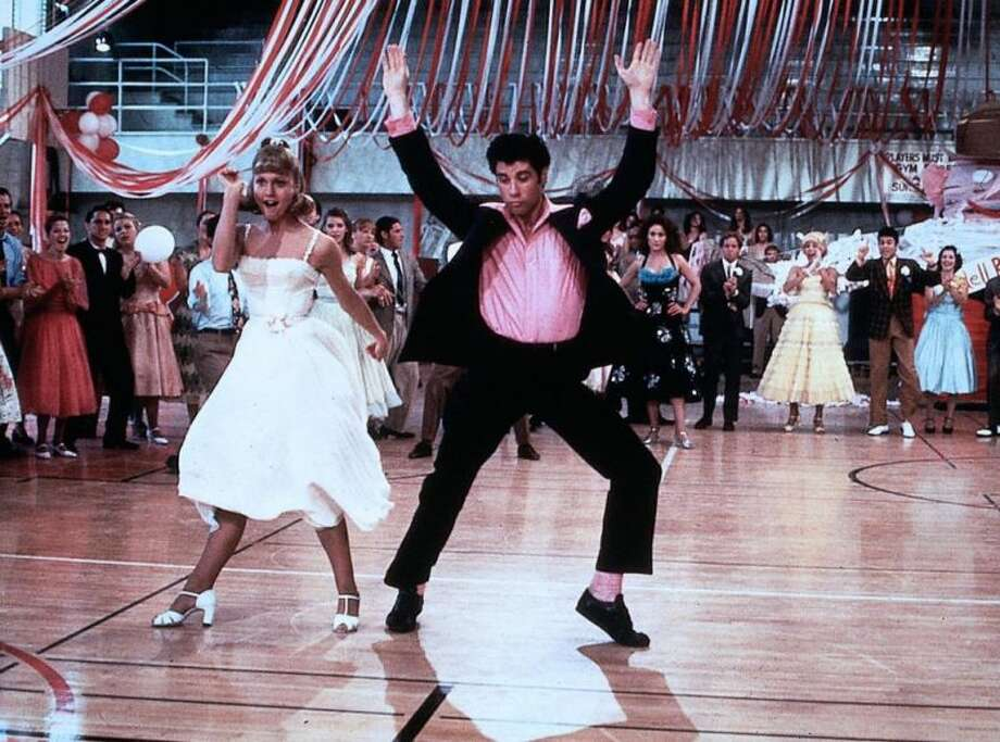 "Danny and Sandy""Grease"" is still the word all these years later. John Travolta and Olivia Newton John as Danny and Sandy are what we think about every June when the mood for ""Summer Lovin' "" strikes. Photo: Paramount Pictures 1978 / ONLINE_YES"