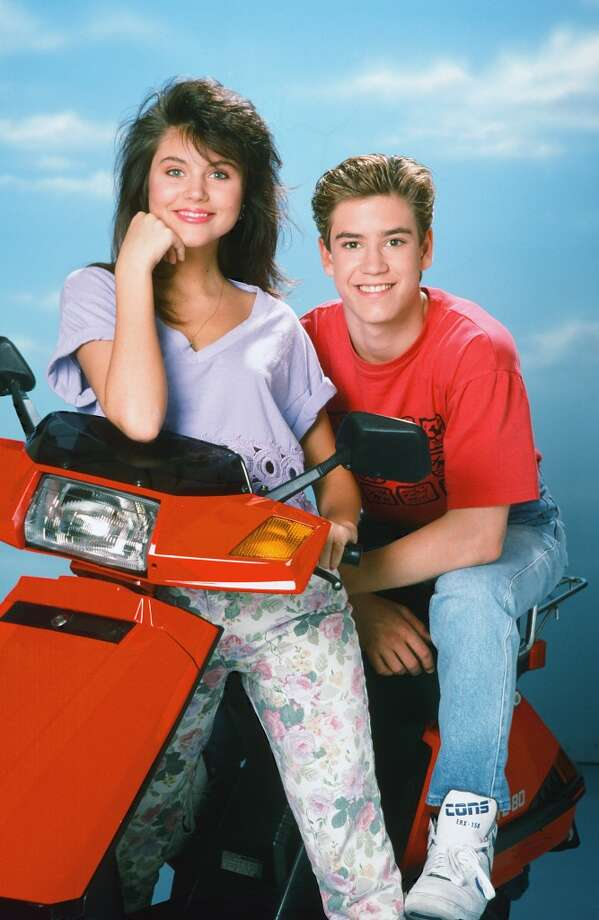 "Zack Morris and Kelly Kapowski""Saved by the Bell"" may not have had the romantic stakes of a nighttime drama like ""90210,"" but the Saturday morning favorite kept us guessing whether teen golden couple Kelly Kapowski (Tiffani Thiessen, née Amber) and  Zack Morris (Mark-Paul Gosselaar) would end up together after graduation. Spoiler alert: The teen couple eventually marry in their college years with Slater, Lisa, Jesse and even Screech in attendance in a special series finale. We'll always have Bay View, and the musical styling a of ""Zack Attack."" Photo: NBC, NBC Via Getty Images"