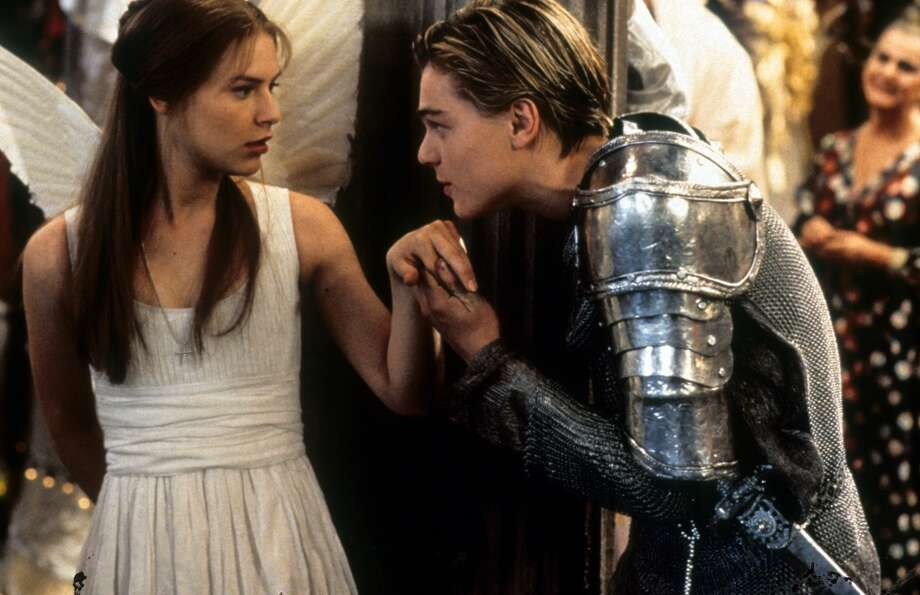 """Romeo + JulietShakespeare wrote the ultimate teen romance centuries before Hollywood existed to coin the term. The lush 1996 """"William Shakespeare's Romeo + Juliet"""" directed by Baz Lurhman, starring Claire Danes and Leonardo DiCaprio as the young lovers, brought the timeless tale to life with eye-popping visuals and one of the best couple introductions on screen courtesy of a fish tank. Cue the light through yonder window breaking. Photo: 20th Century Fox, Getty Images"""