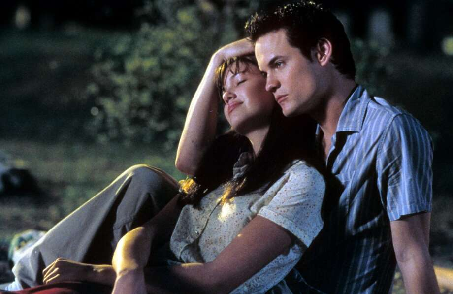 """Jamie Sullivan and Landon CarterThe 2002 film """"A Walk to Remember"""" is recalled by many who came of age in the early 21st century as the tear jerking date movie of all time (we're talking the pre- """"The Notebook"""" years). Jamie Sullivan, (Mandy Moore) and Landon Carter (Shane West) strike up an unlikely, high school-hierarchy defying romance. The catch? Jamie isn't in what one would call the best of health but that doesn't stop Landon from trying to make all her wishes come true. Photo: Archive Photos, Getty Images"""