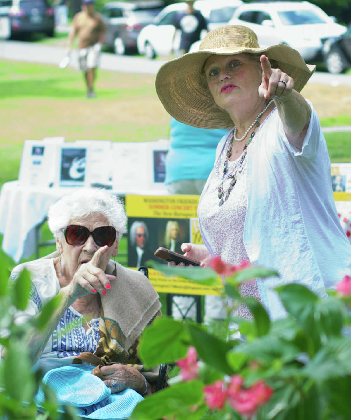 Admiring nearby flowers are Sari Max, right, of Washington, and her aunt, Mazie Bensman of New York City, during the Washington Green Fair, hosted July 12, 2014 by the First Congregational Church of Washington.