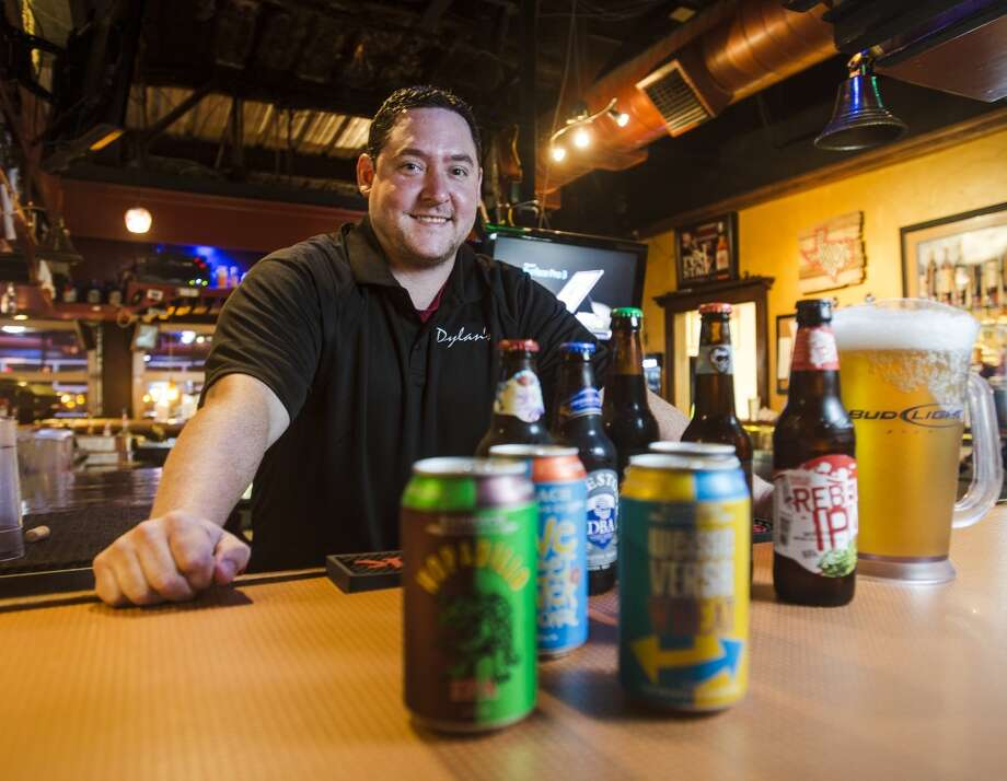 Danny McClintock poses with a selection of beers available at Dylan's on Wednesday afternoon. McClintock has been working at Dylan's on 9th for about 7 years and is the focus of the Cat5 Service Station feature for July 17. Photo taken Wednesday 7/9/14 Jake Daniels/@JakeD_in_SETX