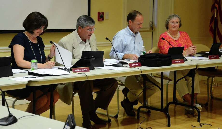 Town Council members Kathleen Corbet, Bill Walbert, Steve Karl and Penny Young at a meeting at Lapham Community Center, New Canaan, Conn., on Wednesday, July 16, 2014, when the council voted to opt into the Commercial Property Assessed Clean Energy program, which aims to encourage green energy projects for commercial buildings. Photo: Nelson Oliveira / New Canaan News