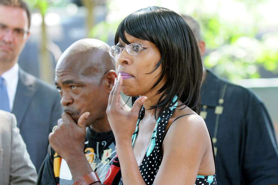 Ezra Prentice Homes resident Deneen Carter-El, right, joins Bebe White, vice president of the tenants association, center, as they talk about the oil trains parked behind their apartments on Wednesday, July 23, 2014, at Ezra Prentice Homes in Albany, N.Y. (Cindy Schultz / Times Union) Photo: Cindy Schultz / 00027891A