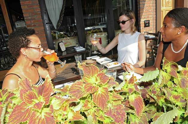 From left, Clotelle Drakeford of Hudson Danielle Von Lehman of Manhatten and Jennifer Richardson of Albany enjoy drinks at Boca Bistro on Broadway on Tuesday, July 22, 2014 in Saratoga Springs, N.Y. (Lori Van Buren / Times Union) Photo: Lori Van Buren / 00027868A