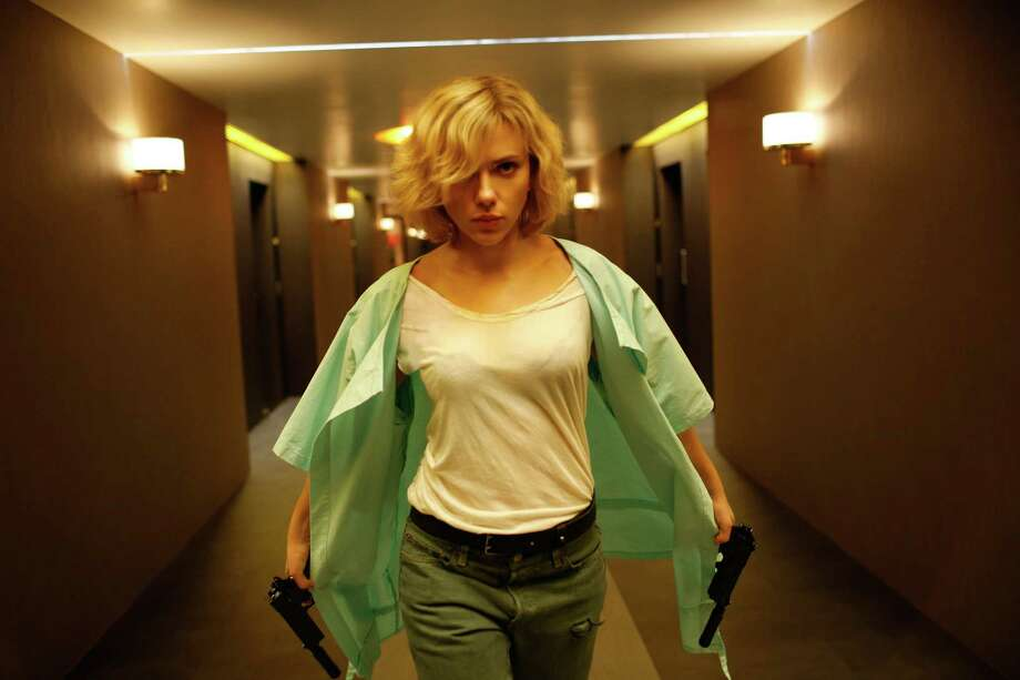 "Scarlett Johansson takes on the title role in the action film ""Lucy."" Photo: Jessica Forde, HONS / Universal Pictures"