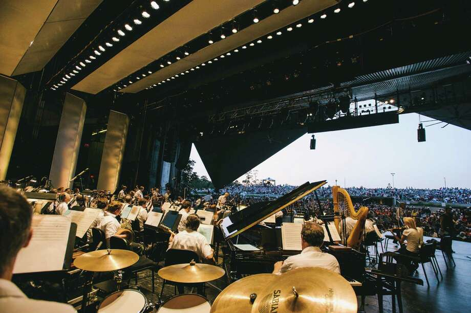 The Houston Symphony warms up for a concert at Miller Outdoor Theatre, where it tweets out information about the music during concerts. Photo: Courtesy Photo / Fotowerk Group