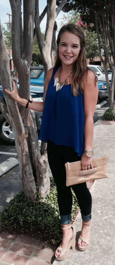 Sarah Burkholder a perfect example of a fashion balancing act. Here her voluminous cobalt blue spaghetti-strapped top is the perfect pick for her skinny dark denim jeans, cuffed, we might add. Her corked neutral-hued wedges go well with her gold chain embellished clutch, and her leafy necklace makes a summer statement. - Michael Quintanilla Photo: Photo By Michael Quintanilla / San Antonio Express-News