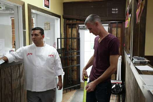 Buddy Valastro and a helper discuss the remodel plans of Not Jus' Donuts. (TLC) Photo: Shane Bissett, TLC / Discovery Communications