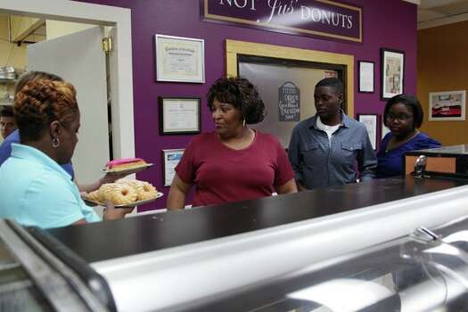 Myrtle Jackson and her staff loading up the showcases at Not Jus' Donuts before the grand reopening. (TLC) Photo: Shane Bissett, TLC / Discovery Communications