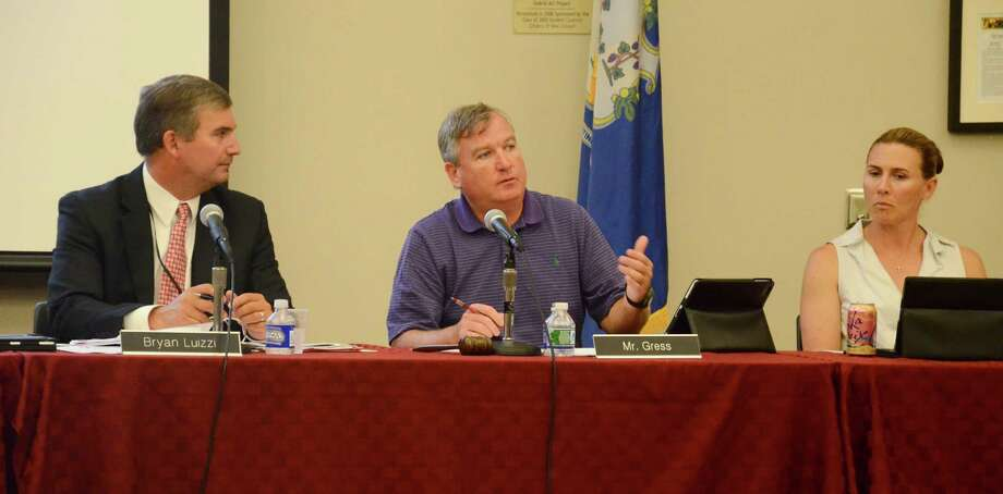 Interim Superintendent of Schools Bryan Luizzi, left, Board of Education Vice Chairman Scott Gress and board member Dionna Carlson at a meeting Monday, July 21, 2014, at New Canaan High School, New Canaan, Conn. Photo: Nelson Oliveira / New Canaan News
