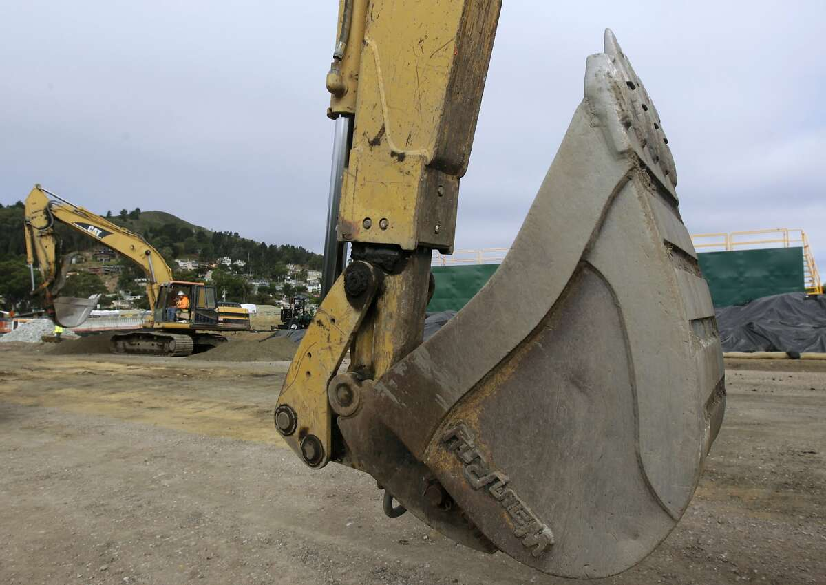 A road crew demolishes the old San Pedro Creek bridge on Highway 1 in Pacifica, Calif. on Wednesday, July 23, 2014. North and southbound traffic on the Coast Highway is being diverted during the project which, when completed in mid-2016, will include a seismically safe, longer and higher bridge over the creek to prevent potential flooding.