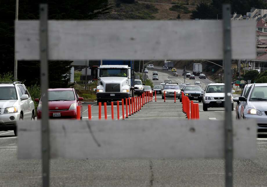 Traffic on Highway 1 is detoured around the old San Pedro Creek bridge which is being demolished and rebuilt in Pacifica, Calif. on Wednesday, July 23, 2014. When completed in mid-2016, the project will include a seismically safe, longer and higher bridge over the creek to prevent potential flooding. Photo: Paul Chinn, The Chronicle
