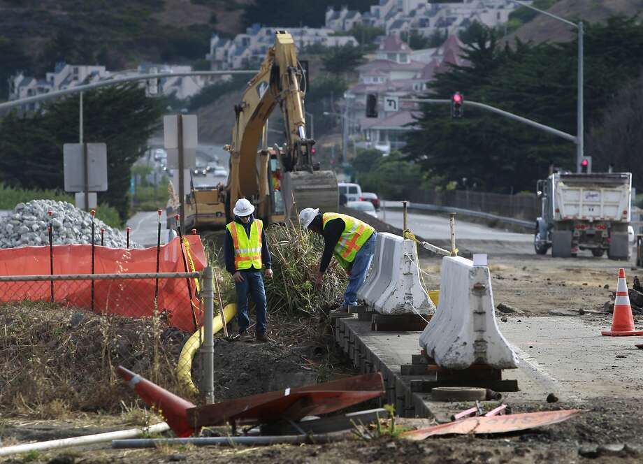 A road crew demolishes the old San Pedro Creek bridge on Highway 1 in Pacifica, Calif. on Wednesday, July 23, 2014. North and southbound traffic on the Coast Highway is being diverted during the project which, when completed in mid-2016, will include a seismically safe, longer and higher bridge over the creek to prevent potential flooding. Photo: Paul Chinn, The Chronicle