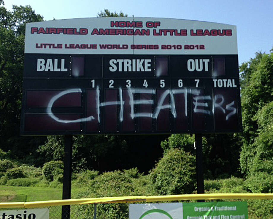 "Graffiti vandals scrawled ""Cheaters"" in spray paint on the scoreboard, dugout and press box of the home stadium of the Fairfield American Little League overnight Tuesday, causing thousands of dollars in damage. Photo: Contributed Photo / Fairfield Citizen"