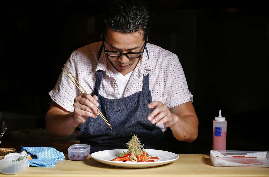 Sho Kamio plates his beet-cured ocean trout. He describes his menu as 40 percent Japanese and 60 percent California. Photo: Russell Yip, The Chronicle