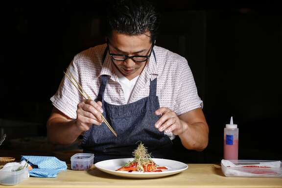 Sho Kamio of Iysasare assembles his Beet Cured Ocean Trout with Yuzu Aioli on Thursday, July 17, 2014 in Berkeley, Calif.