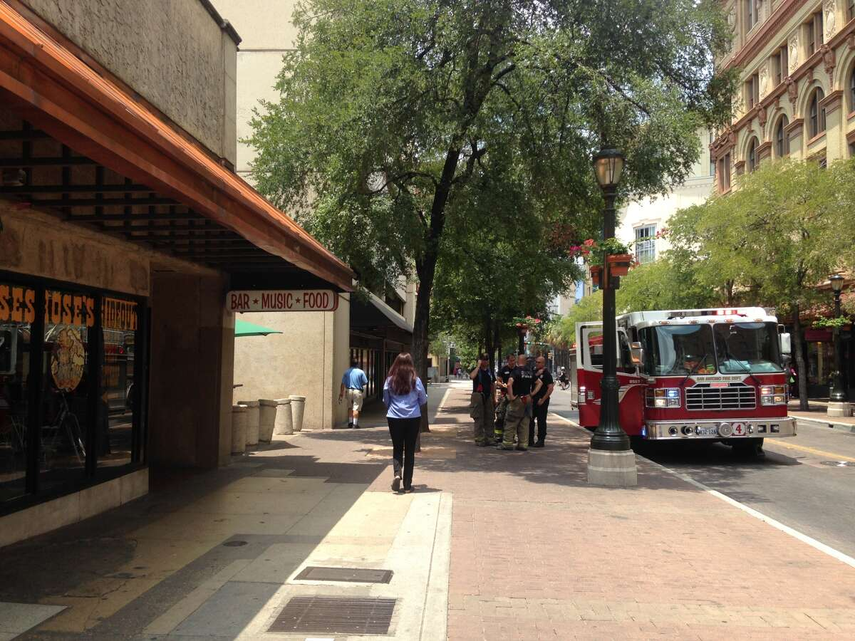 Moses Rose's Hideout, a downwtown restaurant near the Alamo on East Houston Street, was evacuated and closed immediately after an oven caught fire during the downtown rush Wednesday, July 23, 2014. The fire caused about $10,000 worth of damage, fire officials said.