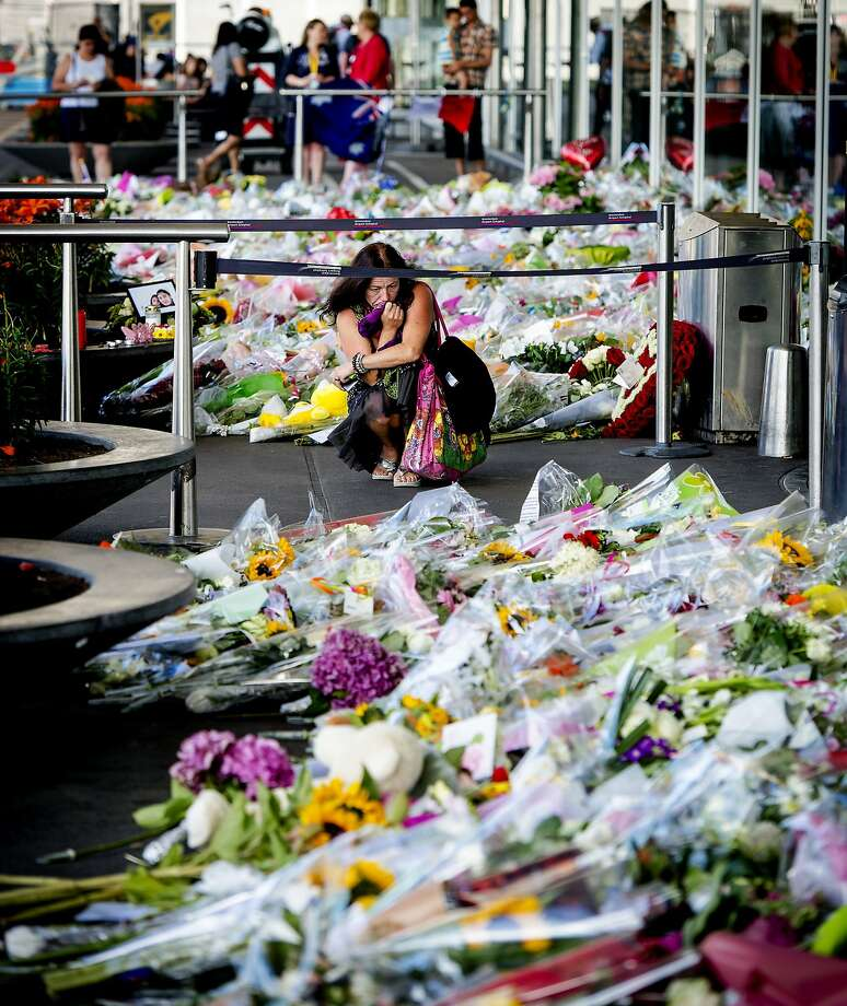 A woman mourns at Amsterdam's main airport for the crash victims. Photo: Robin Van Lonkhuijsen, AFP/Getty Images