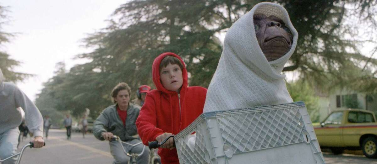 Elliott (HENRY THOMAS), his brother and friends ride as fast as they can to get E.T. back to the forest in a scene from 'E.T. The Extra Terrestrial.' Credit: Bruce McBroom All Rights Reserved
