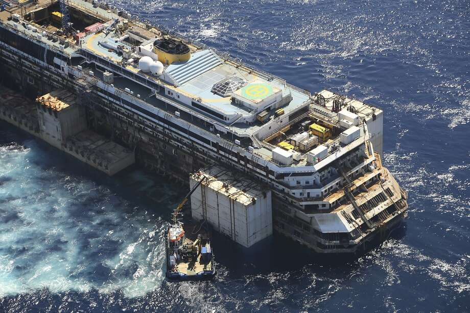 The wreck of the Costa Concordia is towed by two tugboats as it leaves the Tuscan island of Giglio. Photo: Associated Press