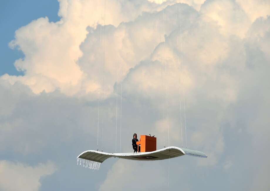 Hitting all the high notes, German pianist Stefan Aaron plays the piano while hovering over Munich's Franz-Josef-Strauss aiport 